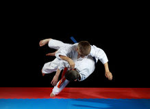 Young athletes in the sharp drop perform judo throw Royalty Free Stock Photo