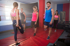 Young athletes stretching legs on exercise mats Stock Photography