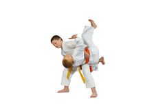 Young athletes train judo throws on a white background Stock Photography