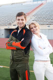 Young athletic couple on athletic field Royalty Free Stock Image