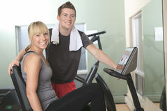 Young athletic couple in gym on training Stock Images