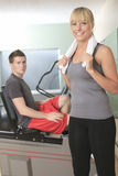 Young athletic couple in gym on training Royalty Free Stock Image
