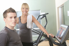 Young athletic couple in gym on training Royalty Free Stock Images