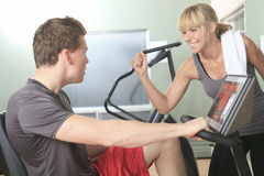 Young athletic couple in gym on training Stock Photo