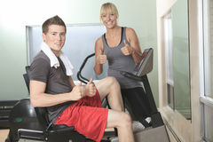 Young athletic couple in gym on training Royalty Free Stock Photography