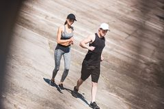 Couple jogging on slabs. Young athletic couple jogging together on slabs Royalty Free Stock Photography