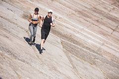Couple jogging on slabs. Young athletic couple jogging together on slabs Royalty Free Stock Images