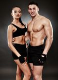 Young athletic couple in sportswear Stock Photos