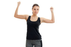 A young athletic girl in black t-shirt had raised two hands up. On white background Stock Photo