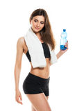 Young athletic girl with a bottle of water and towel on white Royalty Free Stock Photo