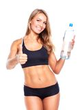 Young athletic girl with bottle of water on white Stock Photo