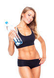 Young athletic girl with bottle of water on white Stock Photography