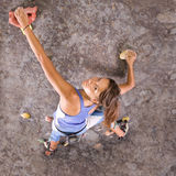 Young, athletic girl climbing royalty free stock image