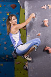 Young, athletic girl climbing royalty free stock photo