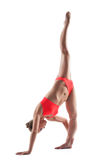 Young athletic girl doing stretching in studio Royalty Free Stock Images