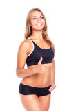 Young athletic girl with a finger up on white Stock Photos