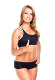 Young athletic girl with a finger up on white Stock Images