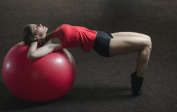 Young athletic girl in the gym Stock Photos