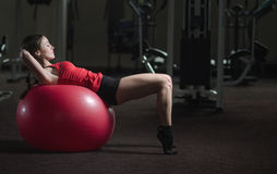 Young athletic girl in the gym Stock Image
