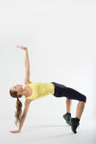 Young athletic girl makes gymnastic bridge Royalty Free Stock Images