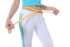 Young athletic girl measuring waist. Royalty Free Stock Photos