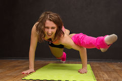 Young athletic girl trains in the gym Stock Photography