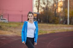 Young athletic girl trains at the stadium. stock images