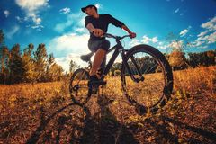 Young athletic guy on a sports bike Stock Photography