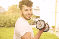 Young athletic male model laughing warm tones filter applied Royalty Free Stock Photos