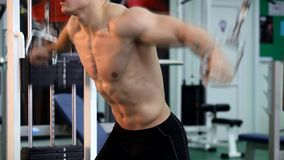 Young athletic man execute muscle exercises. Young athletic bodybuilding man execute muscle exercises stock video footage