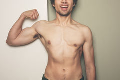 Young athletic man flexing his muscles Royalty Free Stock Photo