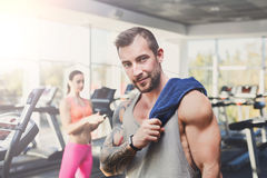 Young athletic man in gym, lifestyle portrait in fitness center Royalty Free Stock Image