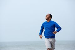 Young athletic man jogging outdoors Royalty Free Stock Image