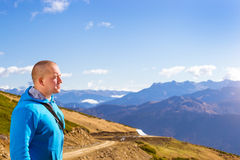 Young athletic man, mountain landscape, Sochi Stock Photo