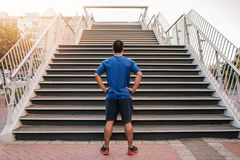 Young athletic man preparing to run up steep stairs Royalty Free Stock Image
