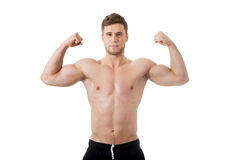 Young athletic man showing his muscles. Stock Photography
