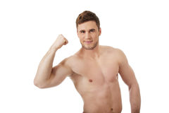 Young athletic man showing his muscles. Royalty Free Stock Photos