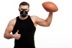 Athletic man boxer with rugby ball Stock Photos