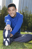 Young Athletic Man Stretching in Beijing Park- Vertical Stock Image