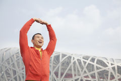 Young athletic man stretching in park, Beijing Stock Photo