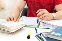 Young athletic man and student studying and writing notes. royalty free stock photo