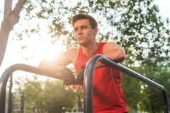 Young athletic man taking a break during working out outdoor. Royalty Free Stock Photo