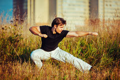 Young athletic man training Stock Photos