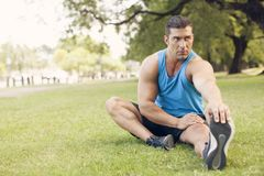 Young athletic muscular man exercising outdoors royalty free stock images