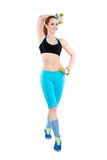 Young athletic red-haired woman in bright sportswear Stock Photos