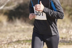 Young athletic runner on a cross country race. Outdoor circuit Stock Photography