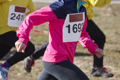 Young athletic runners on a race. Outdoor circuit Stock Photography
