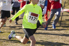 Young athletic runners on a race. Outdoor circuit. Stock Photo