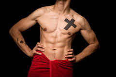 Young athletic shirtless man posing on black background Royalty Free Stock Photo