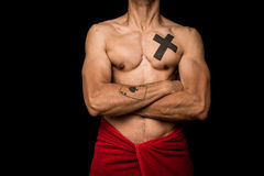 Young athletic shirtless man posing on black background Stock Photo